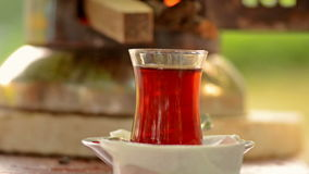 Turkish tea cup. Turkish tea urn and a cup of hot turkish tea stock footage