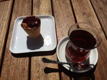 Turkish tea and delisious dessert. Turkish tea and raspberry coconut Royalty Free Stock Photo