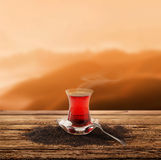 Turkish tea and enjoy the sunset (clipping path) Stock Photos