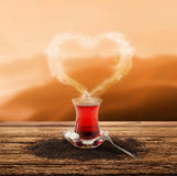 Turkish tea and enjoy the sunset (clipping path) Stock Image