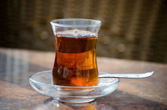 Turkish Tea. In glass cup and spoon on a table Stock Photos