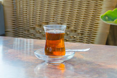 Turkish tea. In glass cup and spoon on a table Royalty Free Stock Photography