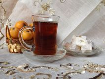 Turkish tea. In glass mug with Turkish sweets and fruits Stock Photo