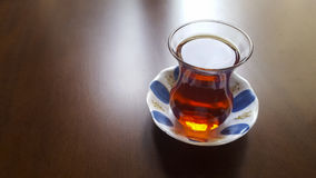 Turkish Tea. A glass of tea served in Turkish style Royalty Free Stock Photo
