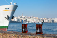 Turkish Tea glassy cups located on seafront parapet Stock Images
