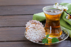Turkish tea with a mini biscuits stock image