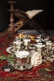 Turkish tea set. Turkish coffee set is an antique cups and ottman stuffs Royalty Free Stock Images