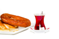 Turkish tea and simit. With cheddar cheese isolated on white background Royalty Free Stock Photos