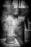 Turkish tea on a stove. Turkish tea (Çai) kept hot on a smoking coal stove, Turkey Stock Image