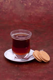 Turkish tea, sugar cubes and cookies. Glass of Turkish tea, sugar cubes and cookies Royalty Free Stock Image