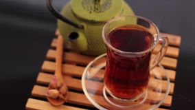 Turkish tea and teapot at cafe. Turkish tea and teapot pan shot stock footage