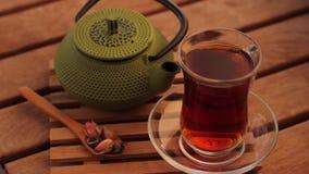 Turkish tea and teapot. Turkish tea and green teapot pan shot stock video
