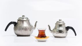 Turkish traditionally tea. Turkish tea and traditional copper teapots Stock Photo