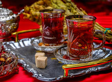 Turkish tea in a traditional cups. On the red background Royalty Free Stock Images