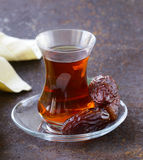 Turkish tea in traditional glass with dates Stock Images