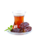 Turkish tea in traditional glass with dates Royalty Free Stock Images