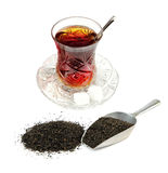 Turkish tea in traditional glass and dry black tea leaves Royalty Free Stock Image