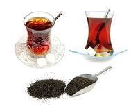 Turkish tea in traditional glasses and dry black tea leaves isolated on white background Stock Images