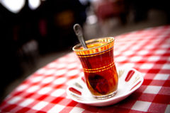 Turkish Tea. Traditional Turkish Tea on Red and white Table Cloth royalty free stock photo