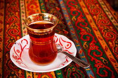 Turkish tea. Traditional tulip-shaped glass for turkish tea Royalty Free Stock Images