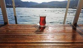 Turkish Tea on the Wooden Landing. In Marmaris, Bozburun in a holiday vacation royalty free stock image