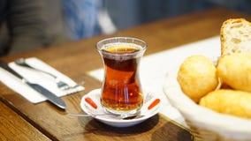 Turkish tea on the wooden table. Turkish black tea on the wooden table with folk and knife Royalty Free Stock Photography
