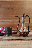 Turkish teapot with arabic decoration. With metal cup Royalty Free Stock Photography