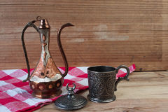 Turkish teapot with arabic decoration. With metal cup Stock Photo
