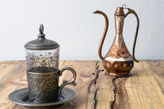 Turkish teapot with arabic decoration. With metal cup and dish Stock Images