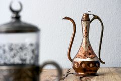 Turkish teapot with arabic decoration with metal cup. And dish Stock Photos