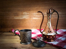 Turkish teapot with arabic decoration with metal cup and dish.  Stock Photography