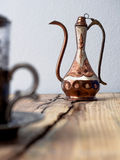 Turkish teapot with arabic decoration. With metal cup in vintage color Stock Photo