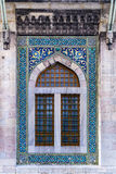 Turkish tiles on mosque window. Ancient mosque window with blue Turkish Iznik tiles Stock Photography