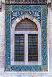 Turkish tiles on mosque window. Ancient mosque window with blue Turkish Iznik tiles Royalty Free Stock Images