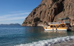 Turkish touristic boat in Butterfly valley, Olu Deniz, Turkey. Turkish touristic boats over calm sea in beautiful lagoon in Butterfly valley, Oludeniz, Turkey Royalty Free Stock Photo