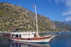 Turkish touristic boats over calm sea in Oludeniz, Turkey. Turkish touristic boats over calm sea in beautiful lagoon in Olu Deniz, Turkey Royalty Free Stock Photography
