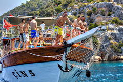 Turkish tourists relaxing on deck excursion yacht, sunny summer Stock Photography