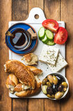Turkish traditional breakfast with feta cheese, vegetables, olives, simit bagel and tea Royalty Free Stock Photos