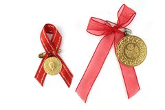 Turkish traditional coins with red ribbon. Royalty Free Stock Images
