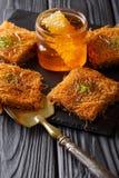 Turkish traditional dessert kadayif with pistachio and honey clo Stock Photography