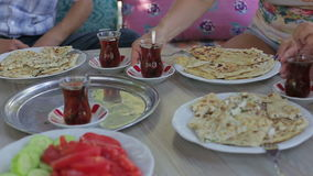 Turkish traditional family dinner. National dishes and tea are on the table stock video