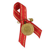 Turkish traditional gold coin with red ribbon. Royalty Free Stock Photo