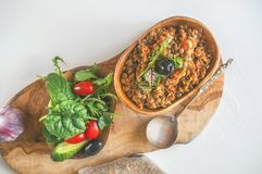 Turkish traditional Lentil salad and a slice of cucumber and green ezogelin, tarhuna. The view from the top. Copy spase. Turkish traditional Lentil salad and a Royalty Free Stock Images
