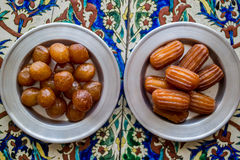Turkish Traditional Lokma and Tulumba Dessert on a Ottoman Pattern. Stock Photo