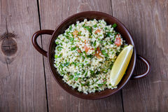 Turkish traditional meal - Taboulé Salad on a wooden table made Royalty Free Stock Photos