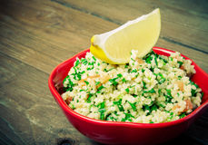 Turkish traditional meal - Taboulé Salad on a wooden table made Royalty Free Stock Photography