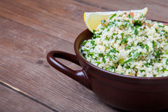 Turkish traditional meal - Taboulé Salad on a wooden table made Stock Image