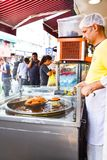 Turkish traditional street food like `cruller` fried dessert with oil , sugar and slightly fermented grape juice stock image