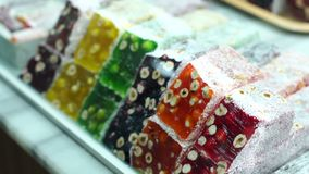Turkish traditional sweets, rahat lukum in counter in the Bazar market. Turkish sweets at the Bazaar. Turkish traditional sweets, rahat lukum in counter in the stock video footage