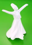Turkish traditional whirling derwish on green background Stock Image